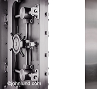 A bank vault door is open to a white interior in a stock photo about security issues.