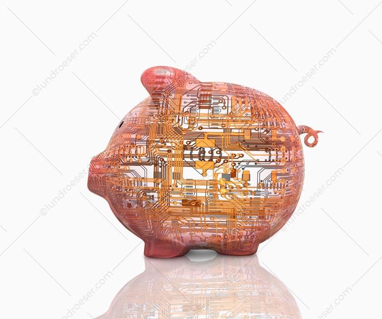 This high tech piggy bank stock photo features a piggy bank superimposed with computer circuitry.