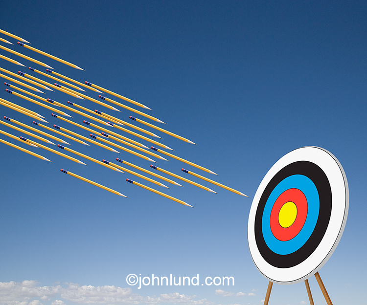 "On target writing is the central theme of this stock photo showing a ""flight"" of pencils about to strike a target. This is an image about mass communications, target writing, and accurate writing as well."