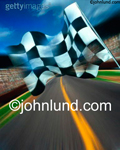 Stock photo of a racing flag, checkered flag, being waved at a race track indicating success and victory.