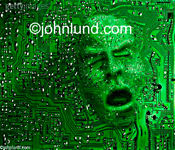 Stock photo of a face emerging through a  printed circuit board, morphing into human features- Electronics, PCB, face