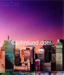 Picture of skyscrapers made of money. Stock photo of a city whose buildings are merged with money.  Deep purple sky.  Real estate invesment and fiancial stock photo. Pix of Money.