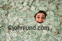 Picture of a happy, smiling and excited  woman buried  up to her eyeballs in money (US. Currency).  The entire frame is full of bank notes with just her happy face exposed. Tons of money pics.