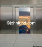 Open elevator doors reveal a high altitude scene some 30,000 feet high in this concept stock photo. Pictures of a space elevator. The interior of the elevator is stainless steel.