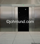 Stock photo of open elevator doors revealing the black star studded vastness of outer space, the universe and a starfield. Space elevator photos.
