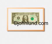 Picture of a framed dollar bill.  The framed first dollar ever earned is suitable for hanging on the office wall. Money pix.