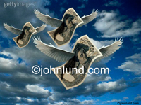 Stock photo of flying francs with a cloudy sky background.  The flying money has real bird wings with feathers.