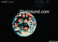 Stock photograph of a group of kids faces superimposed upon the planet earth as see from outer space, the world of children.