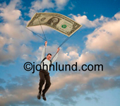 Picture of an African American man skydiving using a dollar for a parachute. Businesman CEO using his golden parachute. Job benefits and security. Stock money photos.