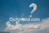 Stock photo  - Picture of  a question mark shaped cloud in the blue sky shows a quest for self discovery and the phiisophical questions of life. Funny cloud pics.