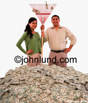 An Hispanic couple stand together in a huge pile of money holding a rake and looking quite pleased. An attractive couple raking in a pile of money.