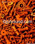 Stock photo of a pile of rusty nuts and bolts: A still life of old rusty parts.