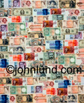 Stock photo of montage of international currencies. A full page with all kinds of paper money, Lira, US, Francs, Chinese, and more.