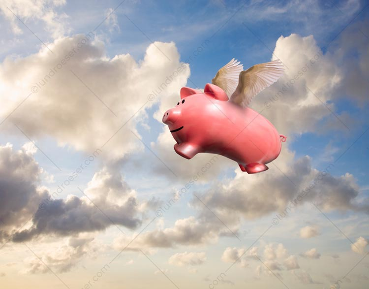 A piggy bank with wings is captured in flight high in a summer sky in an image about financial, investment and savings success.