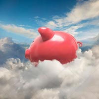 A piggy bank floats in a high-altitude cloudscape in a stock photo about savings, investment and finance in the cloud.