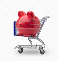 A large pink piggy bank sits in a shopping cart on a white background in a stock photo about shopping for loans, investment opportunities and financial guidance.