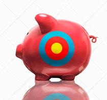 A piggy bank has a target on its side in a stock photo that illustrates concepts of savings, investment and financial strategies and targets.
