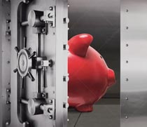 A piggy bank stands inside of a bank vault in a stock photo about safe savings and investment.