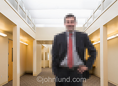 A businessman is pixelated in this stock photo about business, technology and digital issues in business today and tomorrow.
