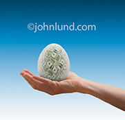 A retirement nest egg, semi-transparent and filled with dollars, is nestled in an outstretched hand in a stock photo about retirement planning, savings, investment and the future.