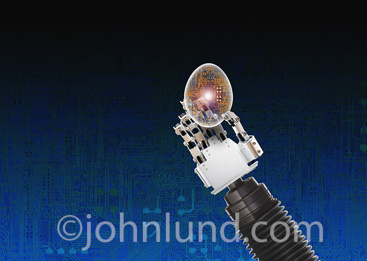 Artificial intelligence and self-creating robots are just two of the concepts behind this stock photo of a robot's hand holding a transparent egg filled with computer circuitry.