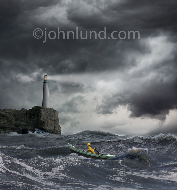 A sailor rows his small boat through rough seas beneath a lighthouse casting its beam of safety through the dark skies in a stock photo about courage, daring, navigation and overcoming adversity.