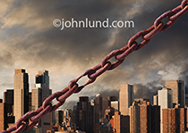 A rusty chain cuts diagonally across the frame, in front of a distant metropolis, with one link stretched thin to breaking point in a visual metaphor for the weak link.