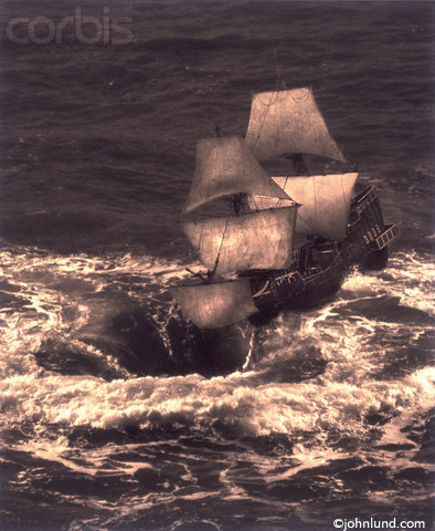 Pictures of a ship going into a whirlpool. The ship is a tall ship with all the sails up as the ship nears the lip of the giant ocean whirlpool.