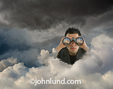 Searching the cloud is the message in this photo of a businessman poking up through clouds and searching with binoculars. Reflected in the binoculars is a golden sunrise while behind the businessman dark storm clouds gather.