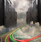 A server room emerges from a cloud bank as multi-colored light trails flow through indicating streaming data in a stock photo about big data, cloud computing, and communications technology.