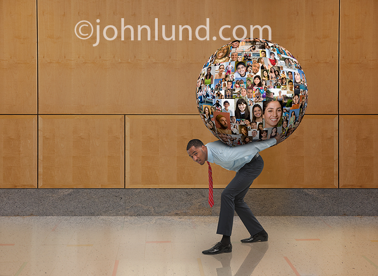 Social Media is seen as a burden in this photo of an African American businessman with a huge globe of peoples' portraits on his back.