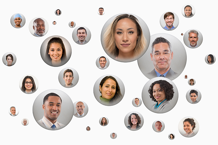 Social media globes float over a white background in a stock photo about social networking, online communities, Internet tribes, and online dating.