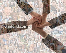 Five hands come together over a background of social media portraits in an image about teamwork, social connections and the formation of online communities, tribes and fan bases.