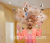 Social media overload is dramatically illustrated in this stock photo of a woman's head exploding into a cloud of individual portraits.