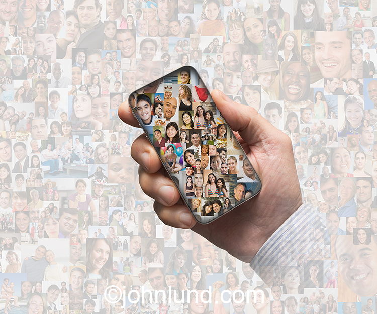 Mobile social media is portrayed in this stock photo by a hand holding up a phone filled with social media portraits against a backdrop of over a hundred ethnically and age diverse additional, greyed-back portraits.