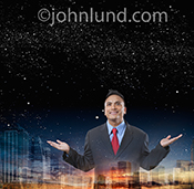 Under a star filled night sky a businessman spreads his arms as a double exposed city stretches across the bottom of the frame in an image about possibilities and success.