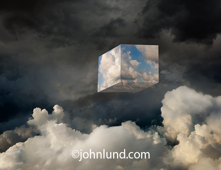 "Cloud computing is illustrated in this stock photo of a ""cube"" of clouds situated in a cloud bank. The cubed clouds, by virtue of their ""man-made"" nature are indicative of cloud computing as a concept as opposed to rain clouds."