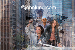 This stock photo is a collage of strong women in the workplace superimposed over a map of the world's continents indicating the important and vital role that women play across the globe.