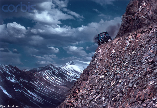 Pictures of a truck on the edge of a cliff in the Himalayas of India. This is in Kashmir on the road to Kardung La, The highest motorable mountain pass in the world.