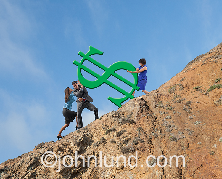 Business teamwork is illustrated in this stock photo of two businesswomen and a businessman struggling together to move a giant green dollar sign up a steep hillside.