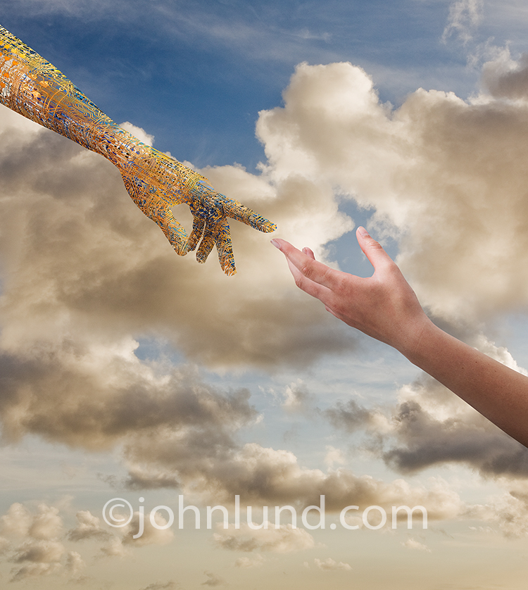 The hand of God, reaching out to a human hand, is a technology hand made from circuitry in a stock photo about robotics, bio-engineering, and spiritual issues.