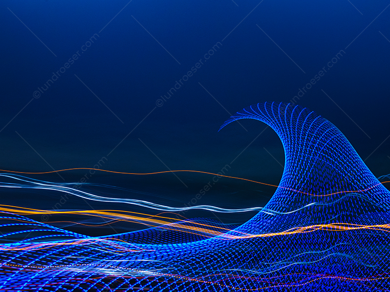 A technology wave is seen in this stock photo of light trails taking on the shape and feel of an ocean, but with a high tech element inherent to it.