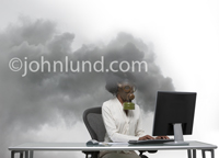 Picture of a woman wearing a gas mask and using a computer as clouds of toxic smoke (spam, malware) pour out of the monitor-display.