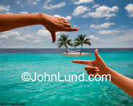 Spa Stock photo of a pair of hands framing a tropical island -  Spa and conceptual photography.
