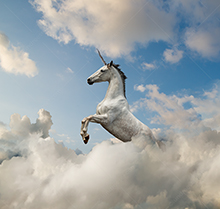 A unicorn rears up in a cloudscape in a stock photo about the magic (and fantasy) of business in the cloud.