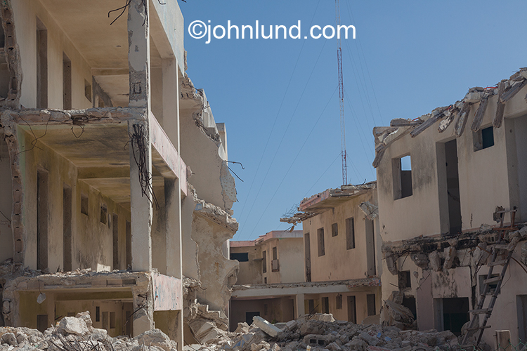 Urban destruction is seen in this stock photo of partially demolished buildings and rubble.
