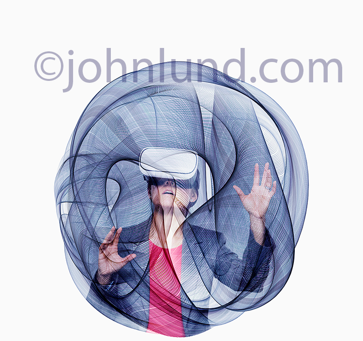A woman wearing virtual reality headgear is seen within a field of swirling lines of energy forming a spherical field of motion in a stock photo about VR.