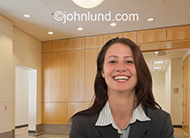The smile this businesswoman is wearing is infectious and her joy is almost palpable.