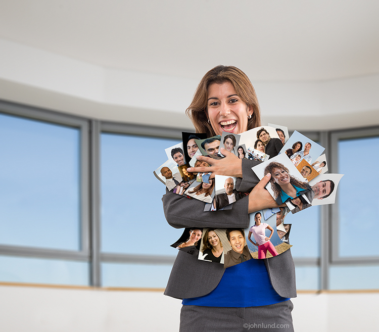 Social media is the theme of this stock image of a woman with her arms full of prints of people's portraits, all of which have a signed model release on file.