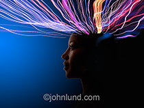 Photo of a woman in profile is metaphorically connected to future technology and communications by streaks of colored light.